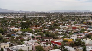 DX0002_145_025 - 5.7K stock footage aerial video orbit and fly away from an urban neighborhood in Tucson, Arizona