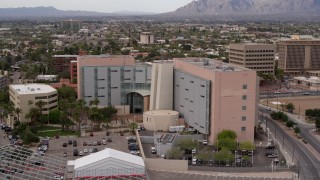 DX0002_145_030 - 5.7K stock footage aerial video of a reverse view of a district court building in Downtown Tucson, Arizona