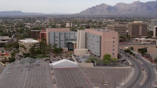 DX0002_145_031 - 5.7K stock footage aerial video approach and orbit a district court building in Downtown Tucson, Arizona