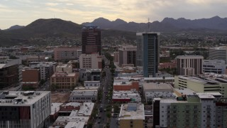 DX0002_145_034 - 5.7K stock footage aerial video of a reverse view of office towers with Sentinel Peak in the background, Downtown Tucson, Arizona