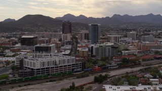 DX0002_145_035 - 5.7K stock footage aerial video of flying away from office towers with Sentinel Peak in the background, Downtown Tucson, Arizona