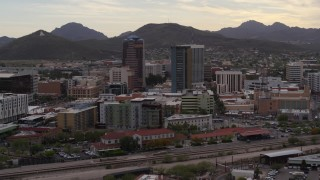 DX0002_145_042 - 5.7K stock footage aerial video descend while orbiting office towers in Downtown Tucson, Arizona