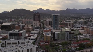 DX0002_145_043 - 5.7K stock footage aerial video ascend for view of Congress Street between office towers in Downtown Tucson, Arizona