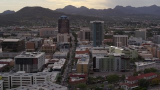 DX0002_145_044 - 5.7K stock footage aerial video descend with view of Congress Street between office towers in Downtown Tucson, Arizona