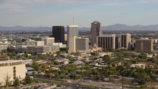 DX0002_146_001 - 5.7K stock footage aerial video three office towers while ascending in Downtown Tucson, Arizona