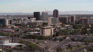 DX0002_146_007 - 5.7K stock footage aerial video approach three office towers behind university office building in Downtown Tucson, Arizona