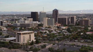DX0002_146_010 - 5.7K stock footage aerial video slowly fly away from three office towers in Downtown Tucson, Arizona