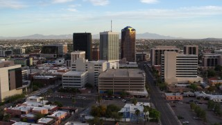 DX0002_146_017 - 5.7K stock footage aerial video of orbiting three office towers in Downtown Tucson, Arizona