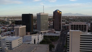 DX0002_146_023 - 5.7K stock footage aerial video approach Bank of America Plaza office tower and ascend in Downtown Tucson, Arizona
