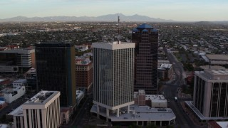 DX0002_146_024 - 5.7K stock footage aerial video orbit and fly away from Bank of America Plaza office tower in Downtown Tucson, Arizona