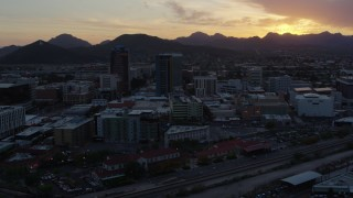 DX0002_146_042 - 5.7K stock footage aerial video of high-rise office towers and Sentinel Peak at sunset in Downtown Tucson, Arizona