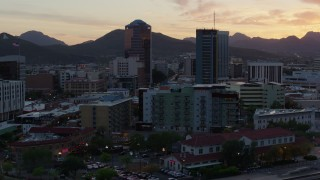 DX0002_147_001 - 5.7K stock footage aerial video focusing on high-rise office towers at sunset in Downtown Tucson, Arizona