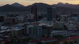 DX0002_147_002 - 5.7K stock footage aerial video focus on high-rise office towers at sunset in Downtown Tucson, Arizona