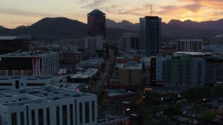 DX0002_147_007 - 5.7K stock footage aerial video of high-rise office towers at sunset with mountains in distance, Downtown Tucson, Arizona