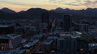 DX0002_147_017 - 5.7K stock footage aerial video office towers at sunset, seen while ascending, Downtown Tucson, Arizona