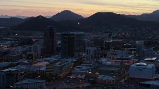 DX0002_147_018 - 5.7K stock footage aerial video tall office towers at sunset, Sentinel Peak in the distance, Downtown Tucson, Arizona