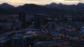 DX0002_147_022 - 5.7K stock footage aerial video slowly approach and flyby tall office towers at sunset, Downtown Tucson, Arizona