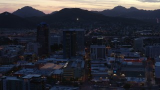 DX0002_147_023 - 5.7K stock footage aerial video slowly passing tall office towers at sunset, Downtown Tucson, Arizona