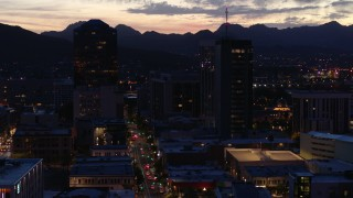 DX0002_147_032 - 5.7K stock footage aerial video slow orbit tall office towers and Congress Street at twilight, Downtown Tucson, Arizona