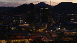 DX0002_147_035 - 5.7K stock footage aerial video of an orbit of three tall office towers at twilight, Downtown Tucson, Arizona