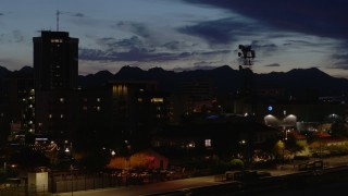 DX0002_147_040 - 5.7K stock footage aerial video flyby tower and tall office buildings at twilight, Downtown Tucson, Arizona