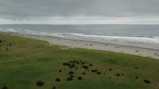 DX0002_148_009 - 4K stock footage aerial video approach and pan across on the beach in Long Beach, Washington
