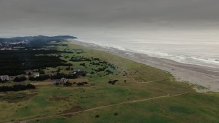 DX0002_148_027 - 4K stock footage aerial video a wide view of beach and ocean waves at sunset in Long Beach, Washington