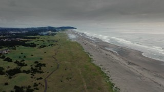 DX0002_148_033 - 4K stock footage aerial video fly away from the beach at sunset in Long Beach, Washington