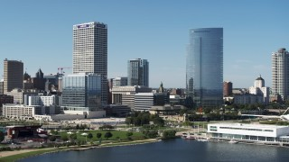 DX0002_149_003 - 5.7K stock footage aerial video of flying away from a pair of skyscrapers in Downtown Milwaukee, Wisconsin