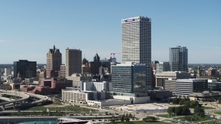 DX0002_149_007 - 5.7K stock footage aerial video of passing tall city buildings and a skyscraper in Downtown Milwaukee, Wisconsin