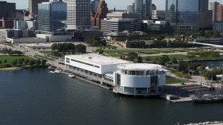 DX0002_149_011 - 5.7K stock footage aerial video of descending near Discovery World museum in Downtown Milwaukee, Wisconsin