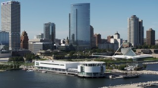 DX0002_149_013 - 5.7K stock footage aerial video of circling the Discovery World museum in Downtown Milwaukee, Wisconsin