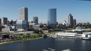 DX0002_149_024 - 5.7K stock footage aerial video of the waterfront museum near city buildings in Downtown Milwaukee, Wisconsin