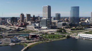 DX0002_149_032 - 5.7K stock footage aerial video of a view of tall skyscrapers seen from Milwaukee Bay, Downtown Milwaukee, Wisconsin
