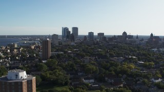 DX0002_150_002 - 5.7K stock footage aerial video of ascending for a wide view of the city's skyline in Downtown Milwaukee, Wisconsin