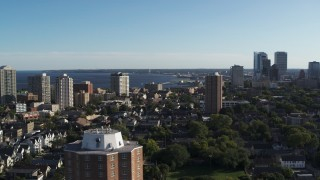 DX0002_150_004 - 5.7K stock footage aerial video of a wide view of a high-rise apartment complex, reveal Downtown Milwaukee, Wisconsin