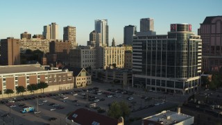DX0002_150_010 - 5.7K stock footage aerial video of a student dormitory complex by parking lot at sunset in Downtown Milwaukee, Wisconsin