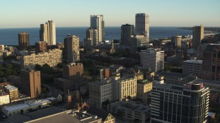 DX0002_150_017 - 5.7K stock footage aerial video of flying by the skyline seen from college campus at sunset in Downtown Milwaukee, Wisconsin