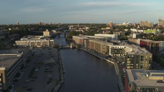 DX0002_150_023 - 5.7K stock footage aerial video apartment complexes by the Milwaukee River at sunset, Milwaukee, Wisconsin