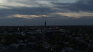 DX0002_150_035 - 5.7K stock footage aerial video of a view of church steeples at twilight, Milwaukee, Wisconsin