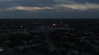 DX0002_150_036 - 5.7K stock footage aerial video of ascending away from church steeples at twilight, Milwaukee, Wisconsin