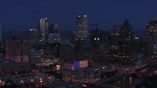 DX0002_151_001 - 5.7K stock footage aerial video flyby skyscrapers and a riverfront office tower at night, Downtown Milwaukee, Wisconsin