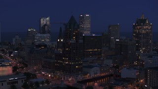 DX0002_151_002 - 5.7K stock footage aerial video of a riverfront office tower at night, Downtown Milwaukee, Wisconsin