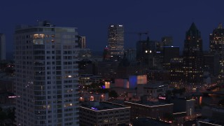 DX0002_151_003 - 5.7K stock footage aerial video of skyscrapers, office tower, reveal apartment tower at night, Downtown Milwaukee, Wisconsin