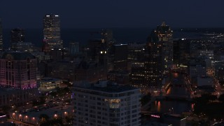 DX0002_151_006 - 5.7K stock footage aerial video of skyscrapers seen while descending by apartment high-rise at night, Downtown Milwaukee, Wisconsin