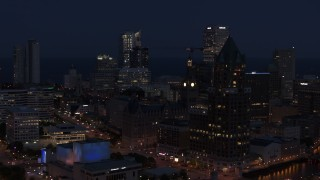DX0002_151_008 - 5.7K stock footage aerial video of skyscrapers at night, seen while passing Milwaukee Center, Downtown Milwaukee, Wisconsin