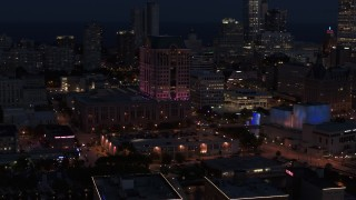 DX0002_151_009 - 5.7K stock footage aerial video orbit a downtown office building at night, Downtown Milwaukee, Wisconsin