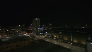 DX0002_151_012 - 5.7K stock footage aerial video of a high-rise apartment building at night, Downtown Milwaukee, Wisconsin