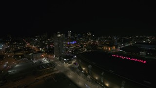 DX0002_151_015 - 5.7K stock footage aerial video approach high-rise apartment building and city skyline at night, Downtown Milwaukee, Wisconsin