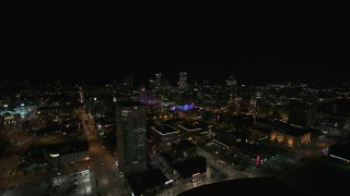 DX0002_151_019 - 5.7K stock footage aerial video a view across downtown toward city skyline at night, Downtown Milwaukee, Wisconsin